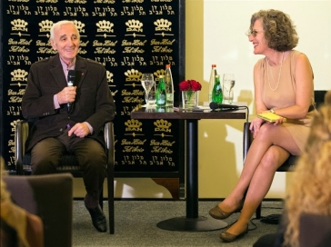 Gisele Abazon in consecutive interpretation with French diplomat and composer Charles Aznavour / AF PHOTO: Jack Guez