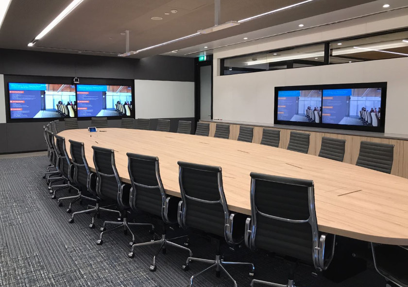 A boardroom set up for remote meeting and distance interpretation