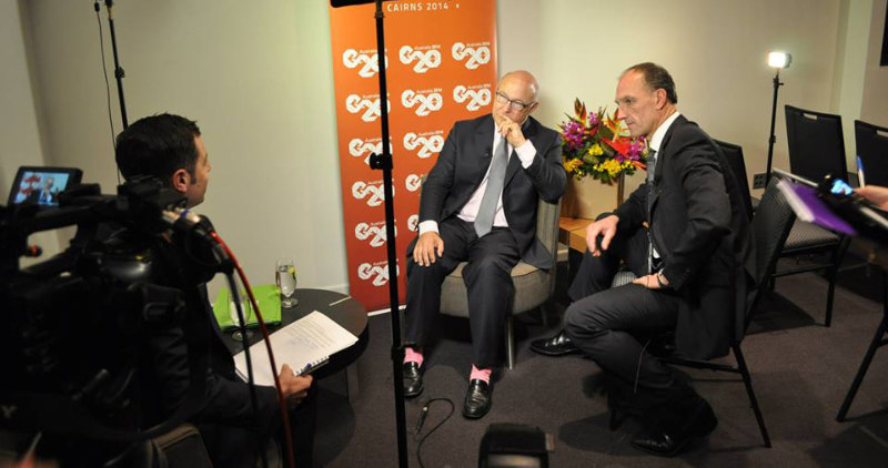 Bertold Schmitt provides whispered Interpretation for the French Finance Minister at the G20