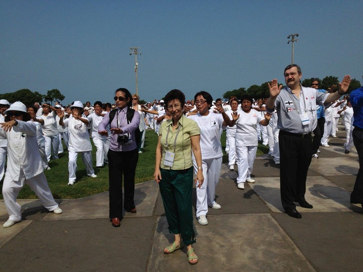 Interpreting with a bidule at a Tai Chi demonstration during the IOC World Conference on Sport for All in Lima, Peru.